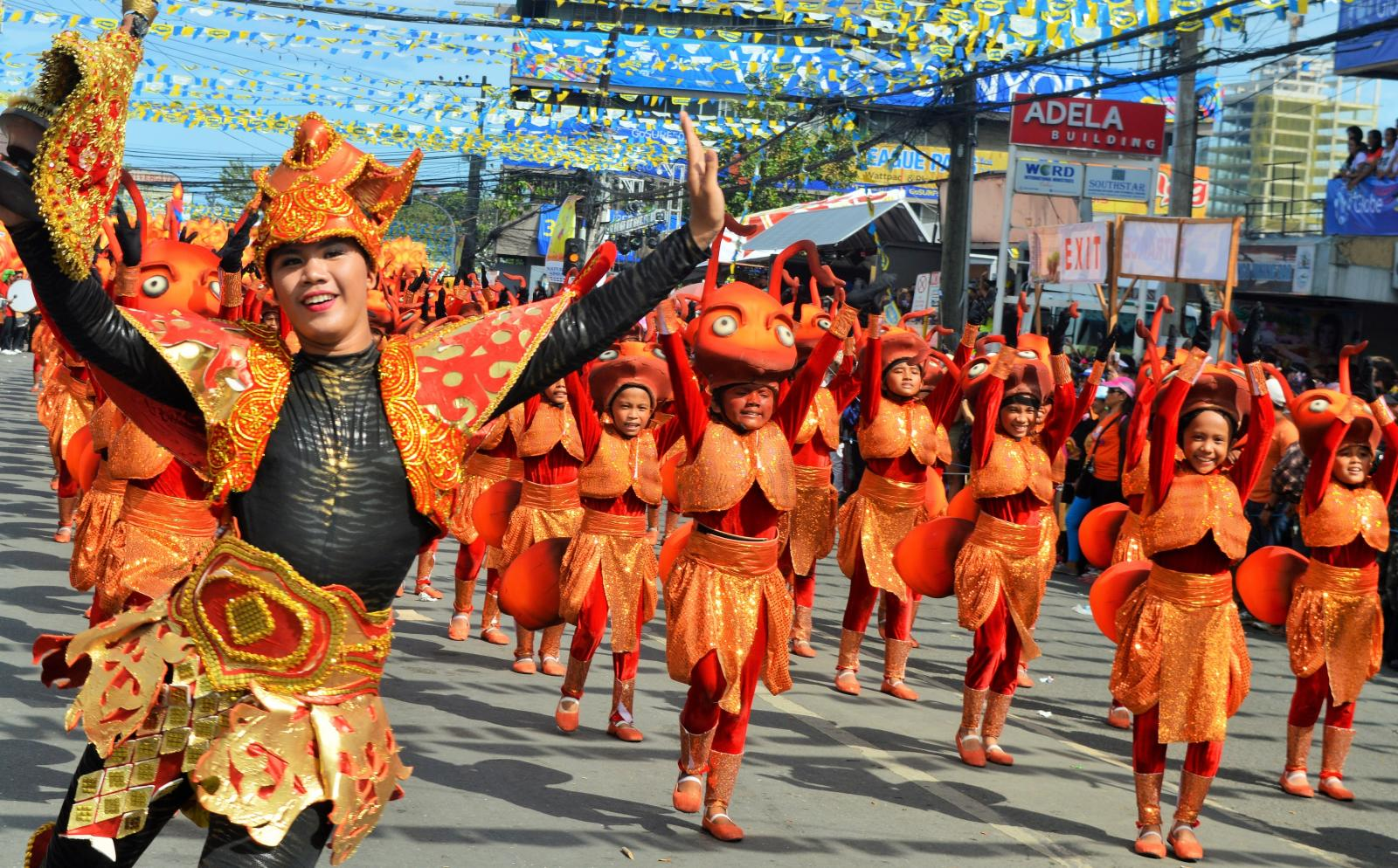 A volunteer studying English in the Philippines attends a local festival to learn about the culture.